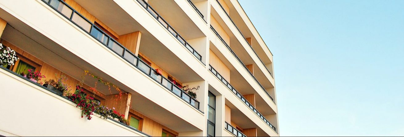 87477733 - modern, luxury apartment building against blue sky